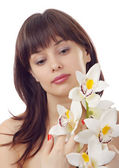 Portrait beautiful woman with flower is — Stock Photo