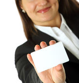 Business woman holds a business card — Stock Photo