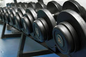 Dumbbells in fitness center — Stock Photo