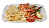 Plate with prawns and french fries — Stock Photo