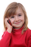 The beautiful young girl speaks by phone — Stock Photo