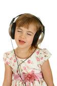 Girl listening music in headphones. — Stock Photo