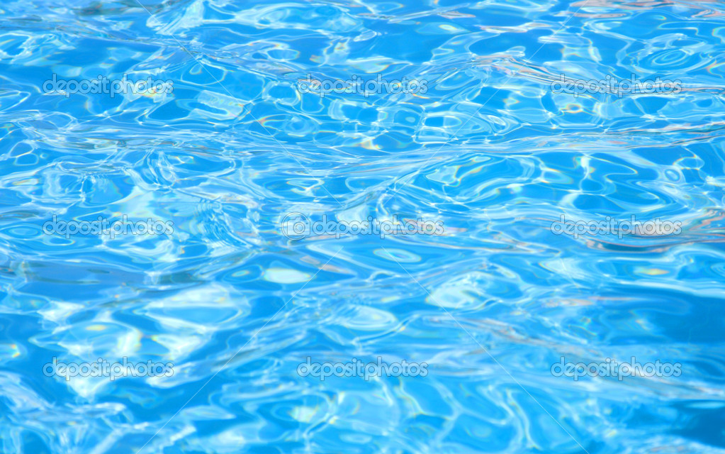 Waves on a surface of water in pool — Stock Photo ...
