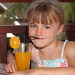 The girl drinks orange juice — Stock Photo #1837804