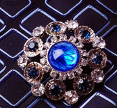 Retro brooch with blue stones — Stock Photo