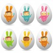 Easter eggs with cute little babies - Stock Photo