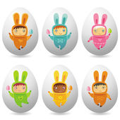 Easter eggs with cute little babies — Stock Photo