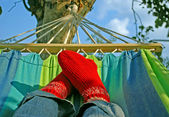 Female Feet in Red Woolen Socks — Stock Photo