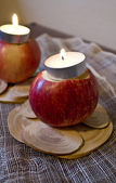 Two Apples with Candles — Stock Photo