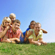 Group of four friends and kids - Stock Photo