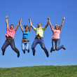 Group of young jumping — Stock Photo