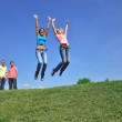 Two girls jumping with their hands up — Stock Photo