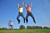 Two guys are jumping with their hands up — Foto de Stock