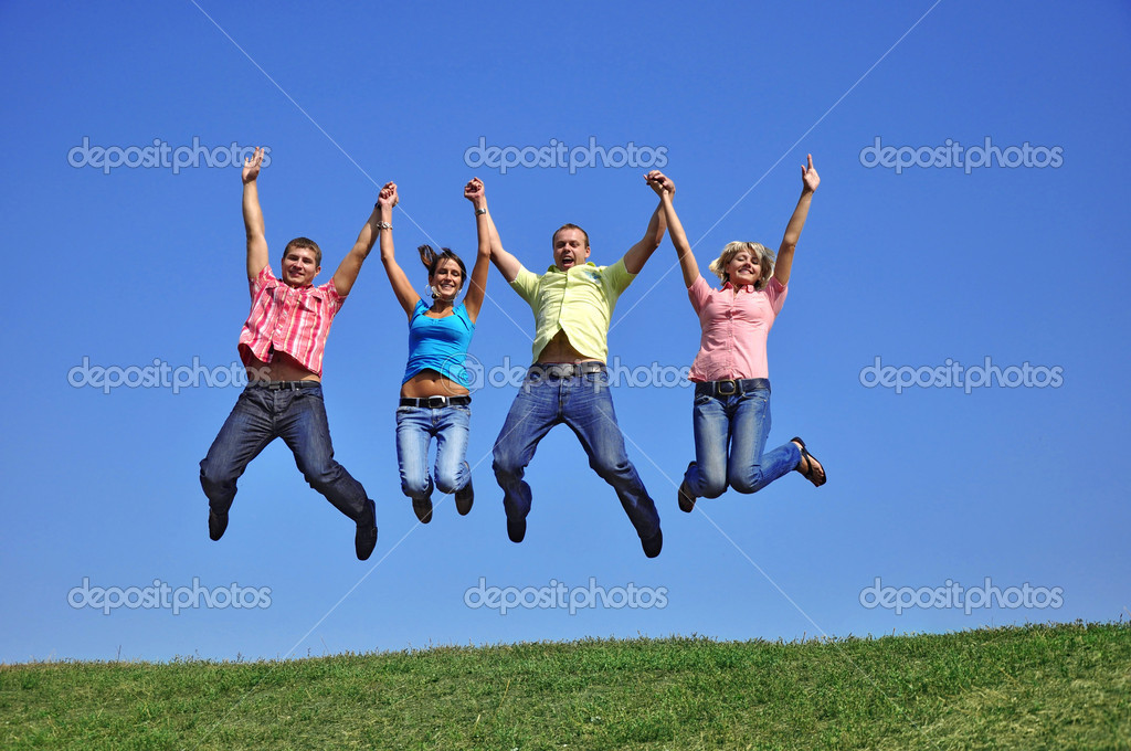 Big group of young jumping with hands up — Stock Photo #1218248