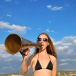 Girl shouting into a megaphone — Stock Photo #1220633