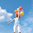 Happy girl with balloons — Stock Photo