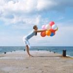 Happy girl with balloons — Stock Photo #1221349
