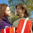 Young couple gives gifts — Stock Photo