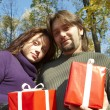 Young couple gives gifts — Stock Photo #1233068