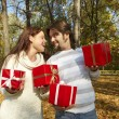Young couple gives gifts — Stock Photo #1233117