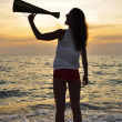 Royalty-Free Stock Photo: Girl shouting into a megaphone