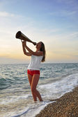 Girl shouting into a megaphone — Stock Photo