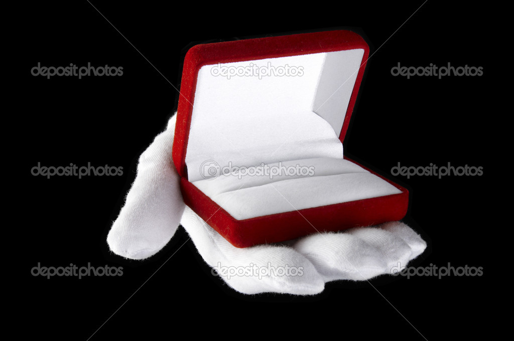 Hands in white gloves presented with an open box for jewelry — Stock Photo #2097292