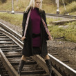 Woman on railway tracks — Stock Photo #1225876