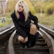 Stock Photo: Woman on railway tracks