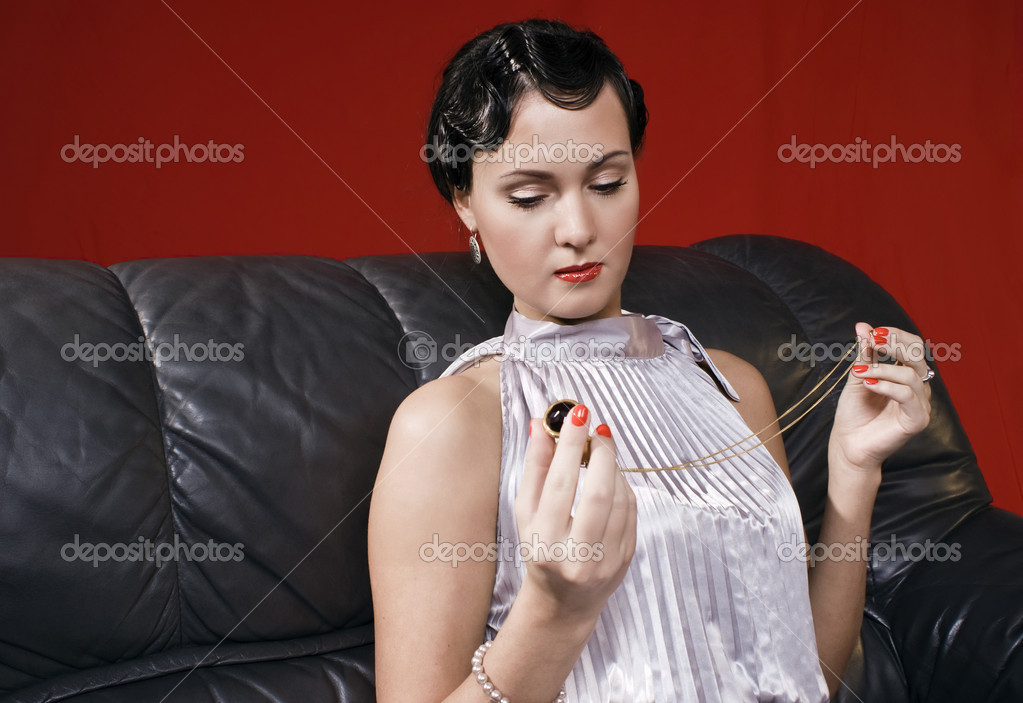 Beautiful young woman in a retro style — Stock Photo #1226443