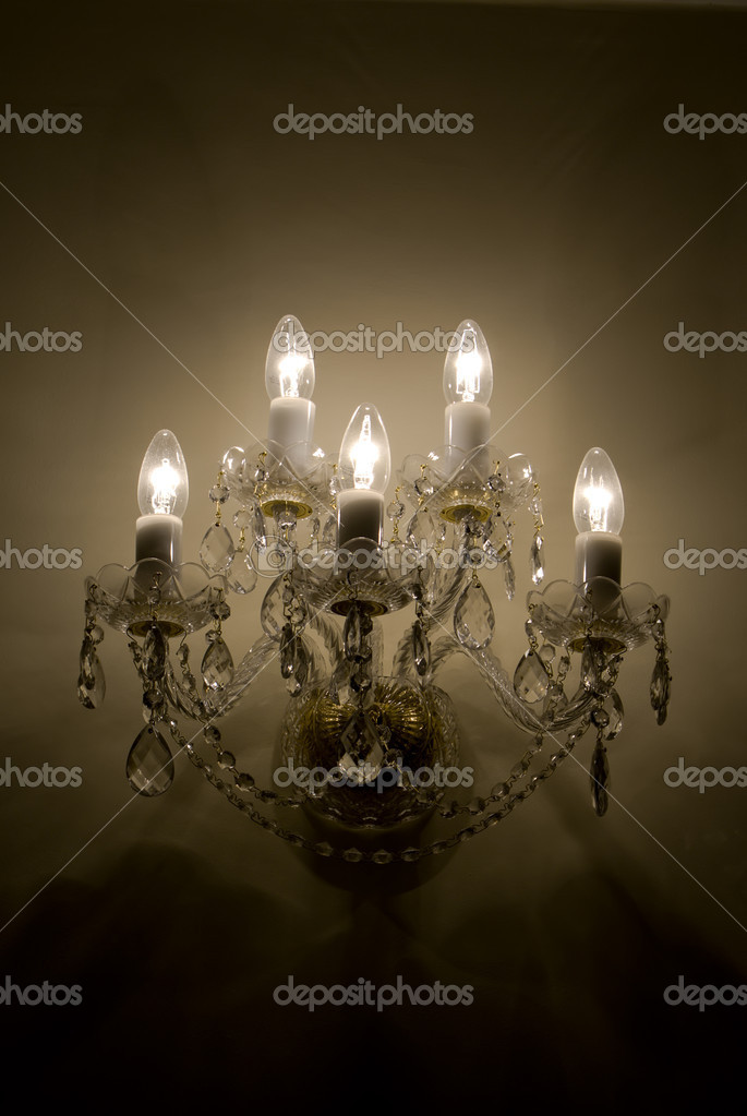 Sconce an empire style on a wall — Stock Photo #1239010