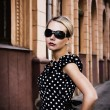 Beautiful girl in sunglasses on city str — Stock Photo #1240614