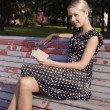 Стоковое фото: On a bench in a summer garden