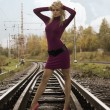 Woman on railway tracks — Lizenzfreies Foto