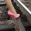 Female foot bases on rails — Stock Photo