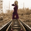 Woman on railway tracks — Stock Photo #1249201