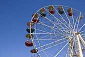 Big wheel on a background of the blue sk — Stock Photo