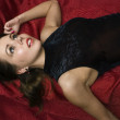 Dead woman lying on the sofa - ストック写真