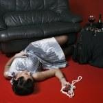 Poisoned woman lying on the floor — Stock Photo
