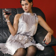 Beautiful young woman with a glass of wi - Stock Photo