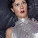 Dead woman lying on the sofa. Studio sho — Stock Photo