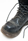 Old boot with laces — Stock Photo