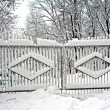 Gates covered with snow - Stock Photo