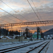 Stock Photo: Sunset on railway station