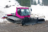 Pink snowcat in the dirt — Stock Photo