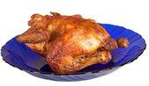 Roasted hen on blue dish — Stock Photo