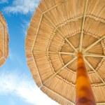 Sunshades and cloudy sun — Stock Photo