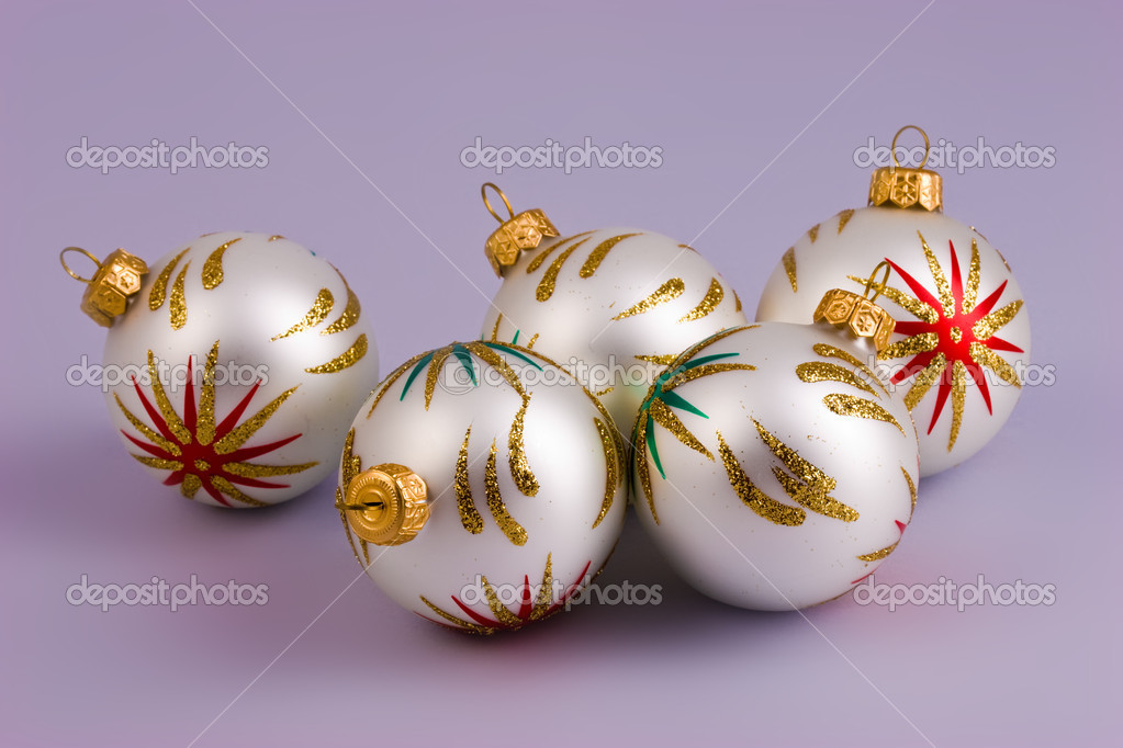 Five Christmas baubles on the violet background — Stock Photo #1228876