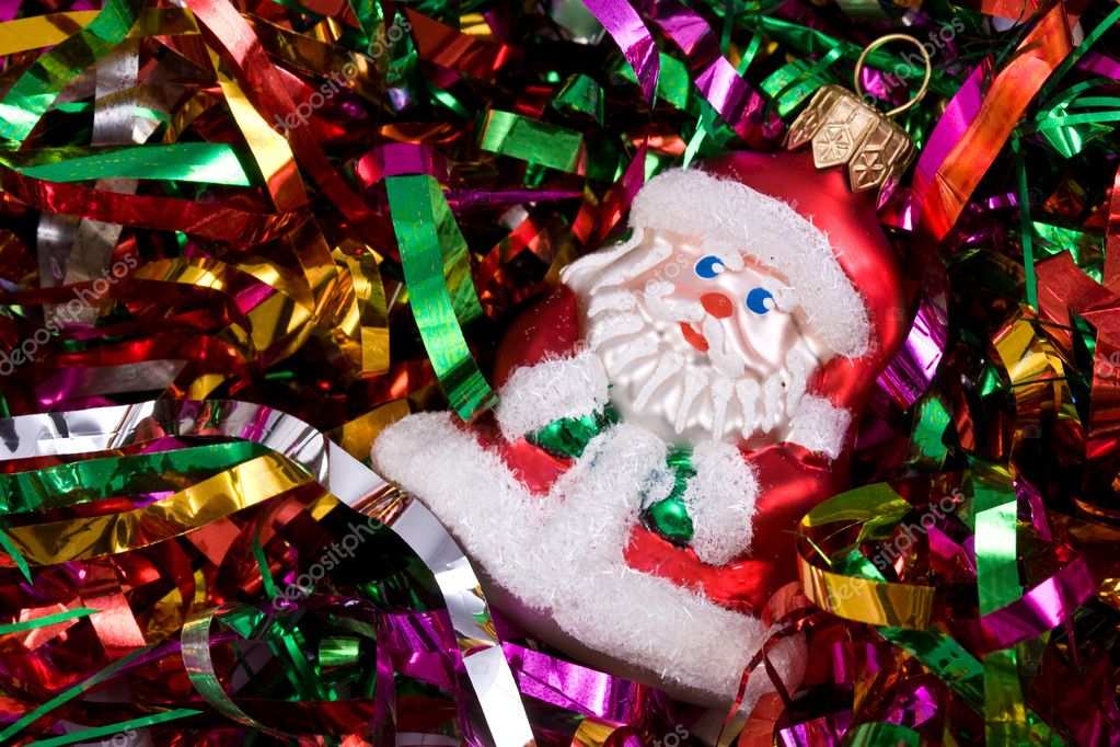 Funny Santa on the colored streamer — Stock Photo #1229494