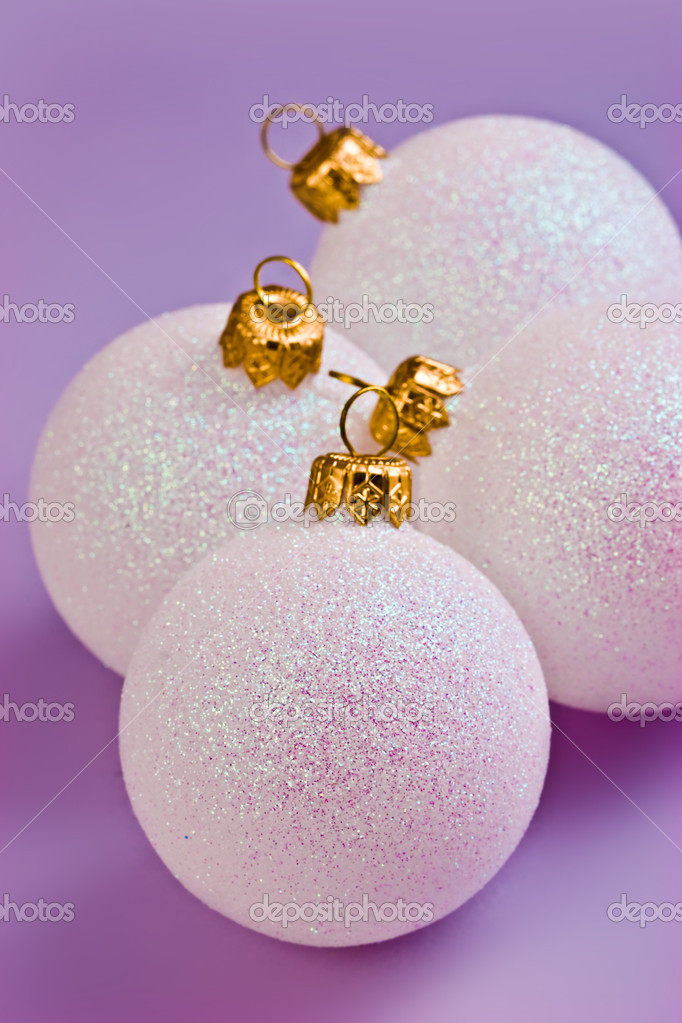 Four white balls on the violet background — Stock Photo #1229553